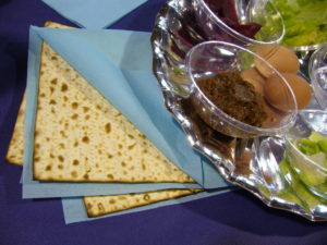 Part of a silver full seder plate with matzah on the side